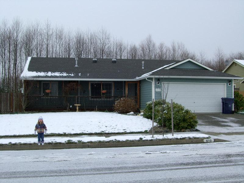 0113.CIMG0146.KimberFrontOfHouse-Snow.jpg