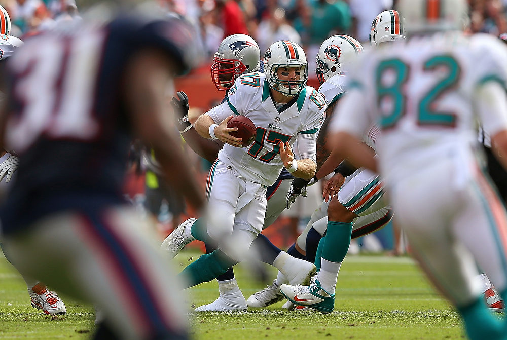 Description of . Ryan Tannehill #17 of the Miami Dolphins scrambles during a game against the New England Patriots at Sun Life Stadium on December 2, 2012 in Miami Gardens, Florida.  (Photo by Mike Ehrmann/Getty Images)