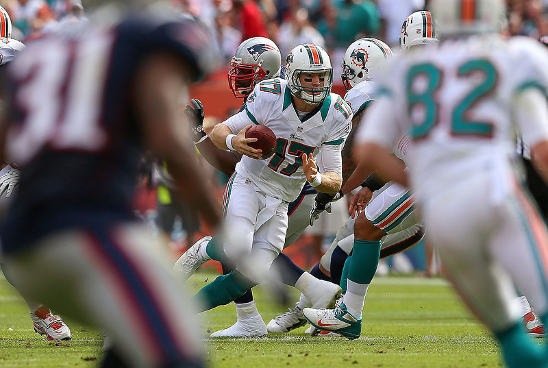 . Ryan Tannehill #17 of the Miami Dolphins scrambles during a game against the New England Patriots at Sun Life Stadium on December 2, 2012 in Miami Gardens, Florida.  (Photo by Mike Ehrmann/Getty Images)