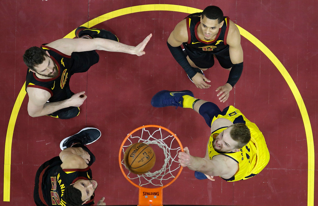 . Indiana Pacers\' Domantas Sabonis, right, from Lithuania, dunks the ball against Cleveland Cavaliers\' Larry Nance Jr., left to right, Kevin Love, and Jordan Clarkson in the second half of Game 7 of an NBA basketball first-round playoff series, Sunday, April 29, 2018, in Cleveland. The Cavaliers won 105-101. (AP Photo/Tony Dejak)