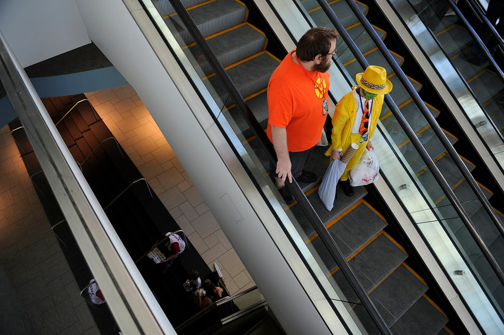 . Comic Con attendees ride the escalator down as the convention winds down during Denver Comic Con at the Colorado Convention Center on June 2, 2013 in Denver, Colorado. (Photo by Seth McConnell/The Denver Post)