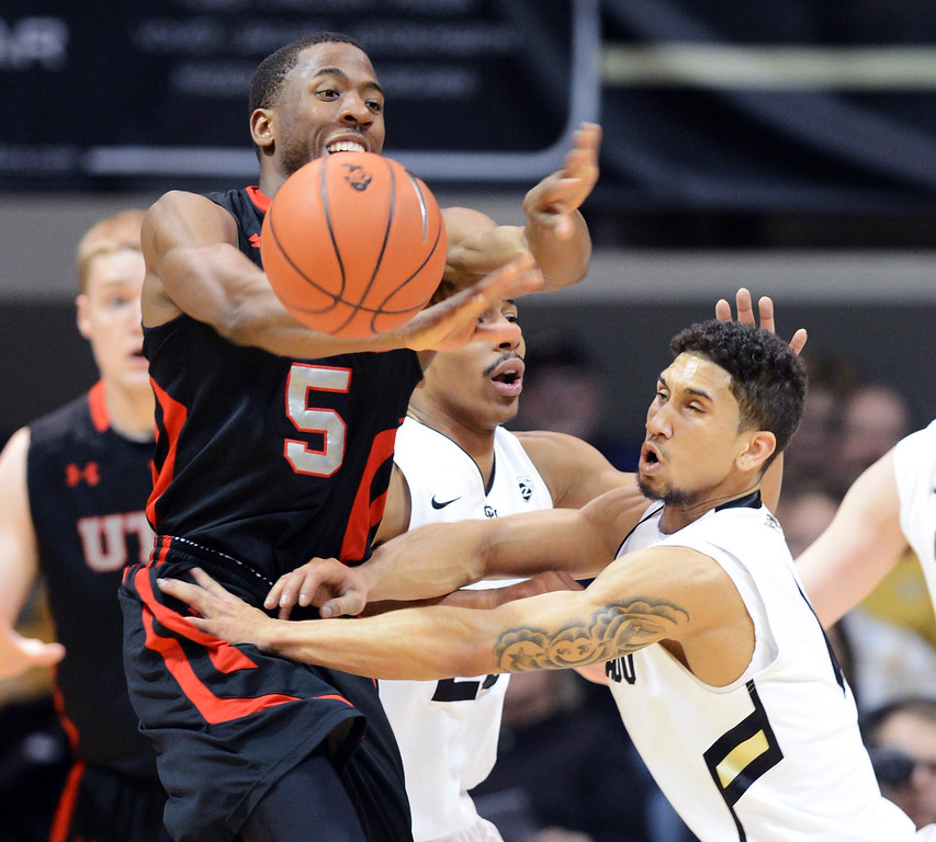 . Askia Booker, right, of Colorado, knocks the ball from Jarrod DuBois of Utahduring the first half of the February 21st, 2013 game in Boulder. For more photos of the game, go to www.dailycamera.com. Cliff Grassmick / February 21, 2013