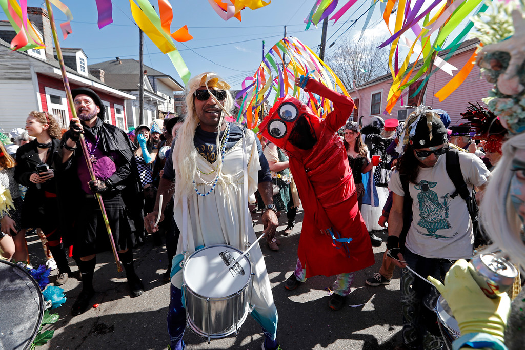 . Revelers dance and play music during the Society de Sainte Anne parade, on Mardi Gras day in New Orleans, Tuesday, Feb. 13, 2018. (AP Photo/Gerald Herbert)