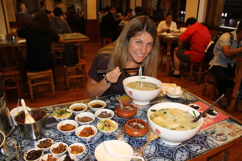 "Alissa eating ""crossing the bridge noodles"" in Kunming"