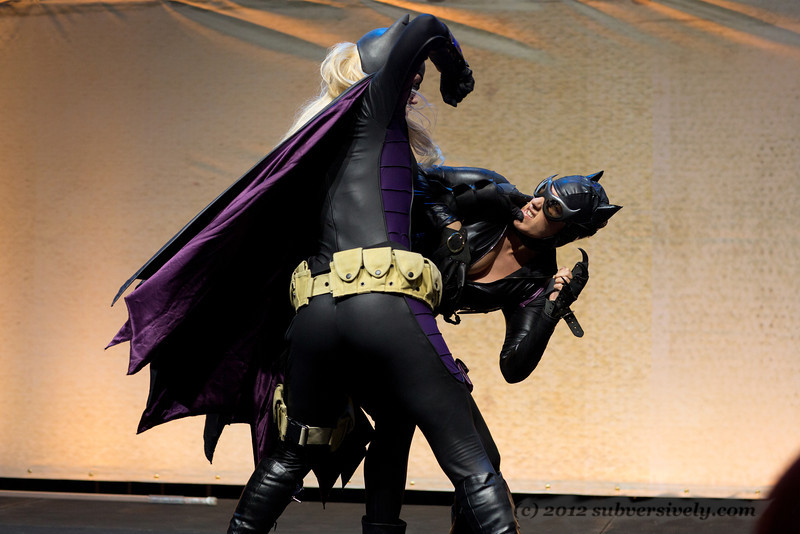 Batgirl (Marisha Ray) gains the upper hand on Catwoman (Robin Sol).