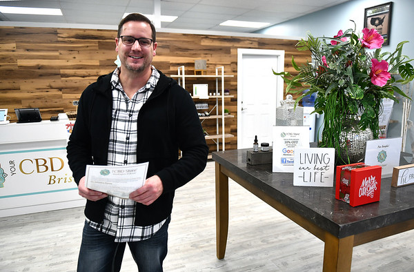 12/5/2019 Mike Orazzi | StaffrYour CBD Store Manager Jeremy Morgan talks about the benefits of CBD oil at the Bristol location. r