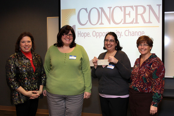 WOW presents check to CONCERN