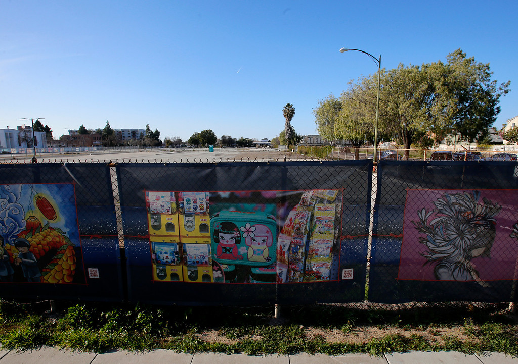 ". An empty lot at looking north on Jackson St. in-between N. 6th St. and N. 7th St. in Japantown in San Jose, Calif., on Monday, Feb. 25, 2013.  In the foreground is a mural from ""The Japantown Mural Project.\""  After years of on-again, off-again plans for development of five acres of the city�s former Corporation Yard in Japantown, the San Jose City Council on Tuesday is expected to approve a term sheet with a developer in an effort to revitalize Japantown with housing, retail, an urban plaza, performance space and strong historical connection.  (Nhat V. Meyer/Staff)"