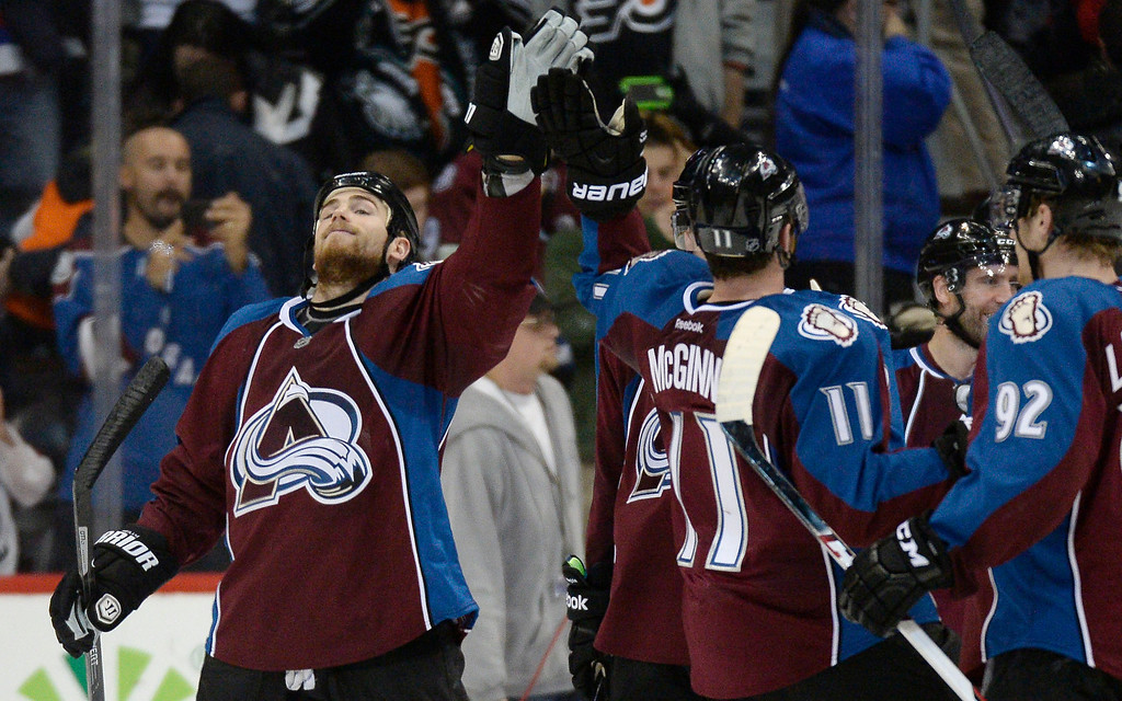 . Colorado Avalanche center Ryan O\'Reilly (90) high fives Colorado Avalanche left wing Jamie McGinn (11) after their win over the Philadelphia Flyers 2-1 January 2, 2014 at Pepsi Center. (Photo by John Leyba/The Denver Post)