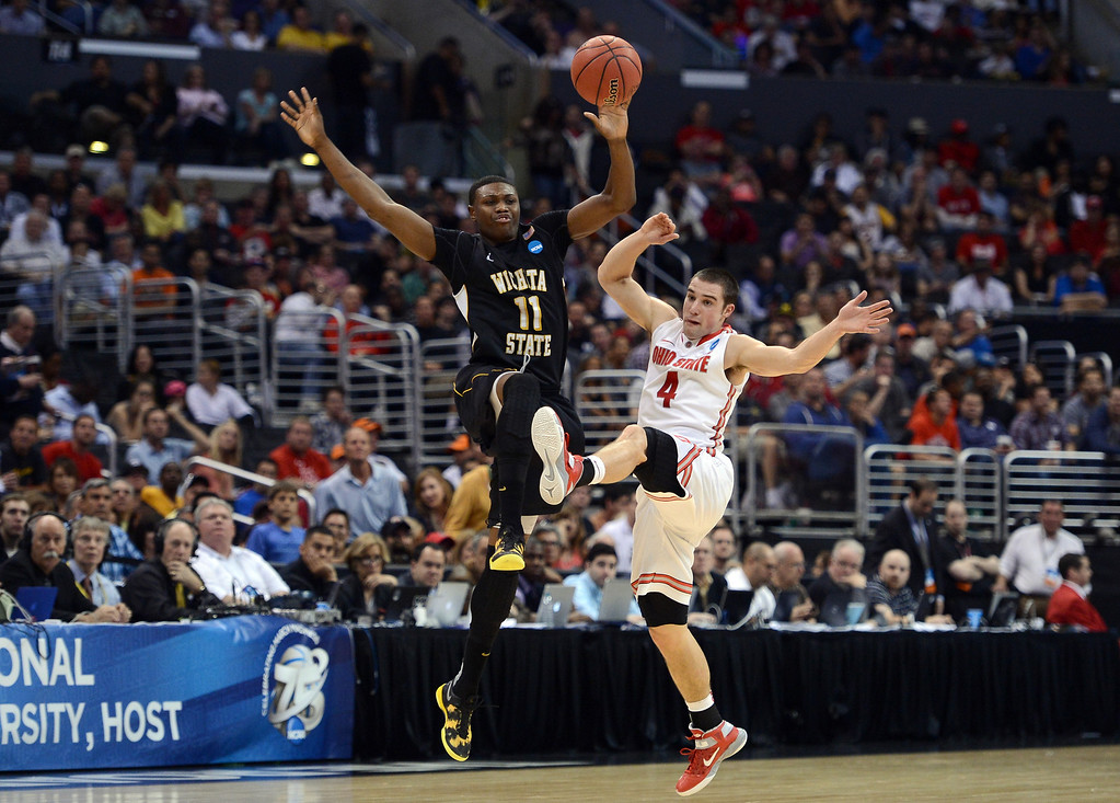 . LOS ANGELES, CA - MARCH 30:  Cleanthony Early #11 of the Wichita State Shockers and Aaron Craft #4 of the Ohio State Buckeyes go after a loose ball in the first half during the West Regional Final of the 2013 NCAA Men\'s Basketball Tournament at Staples Center on March 30, 2013 in Los Angeles, California.  (Photo by Harry How/Getty Images)