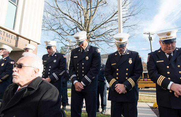 11/14/18 Wesley Bunnell | Staff The New Britain Fire Department unveiled three new fire trucks on Wednesday afternoon during a ceremony at their Beaver St headquarters. Fire department officials bow their heads during the blessing of the new trucks.