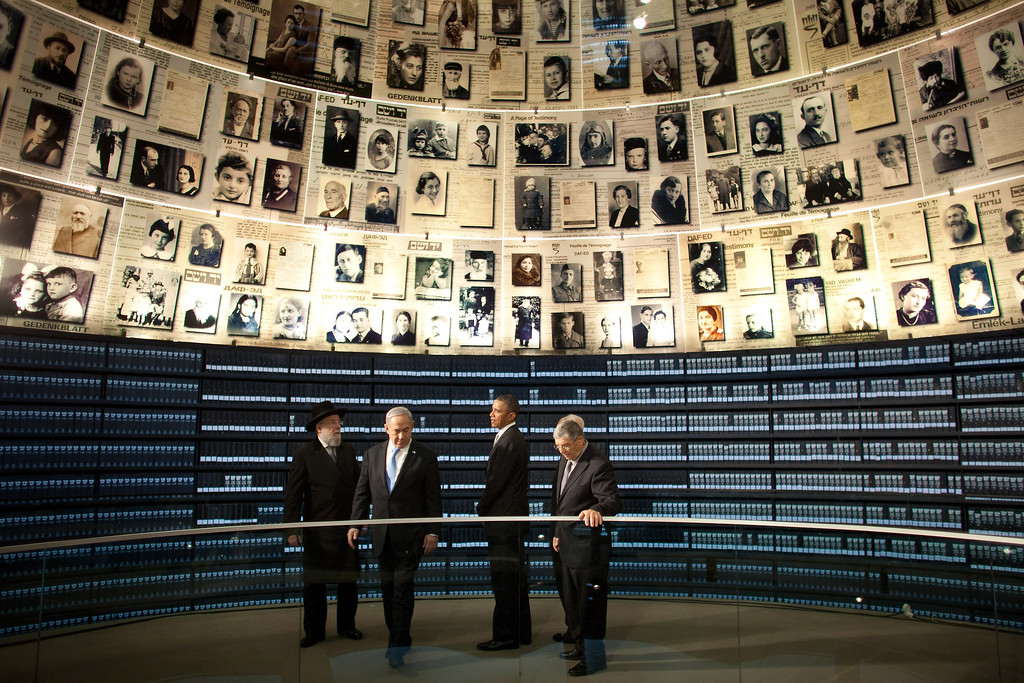 . U.S. President Barack Obama visits the Hall of Names at the Yad Vashem Holocaust Memorial museum with (L-R) Rabbi Yisrael Meir Lau, Israel\'s Prime Minster Benjamin Netanyahu, Chairman of the Yad Vashem Directorate Avner Shalev and Israel\'s President Shimon Peres on March 22, 2013 in Jerusalem, Israel.  (Photo by Uriel Sinai/Getty Images)