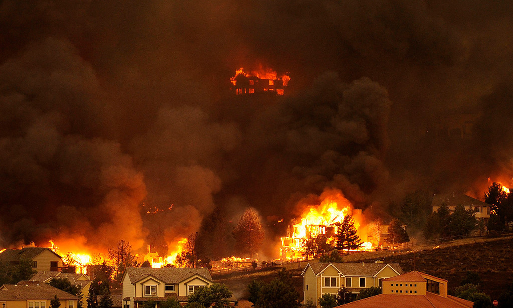 . An entire neighborhood burns near the foothills of Colorado Springs. The Waldo Canyon fire continued to burn northwest of Manitou Springs, Colorado on June 26th, 2012. Helen H. Richardson, The Denver Post