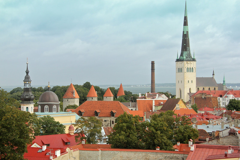 Wonderful view of the some of the Town Wall towers and the 13th century St. Olaf's Church (on right). St. Olaf's 406 ft. tall spire is a Tallinn landmark, and was the tallest building in Europe between 1549 and 1625. -Tallinn, Estonia
