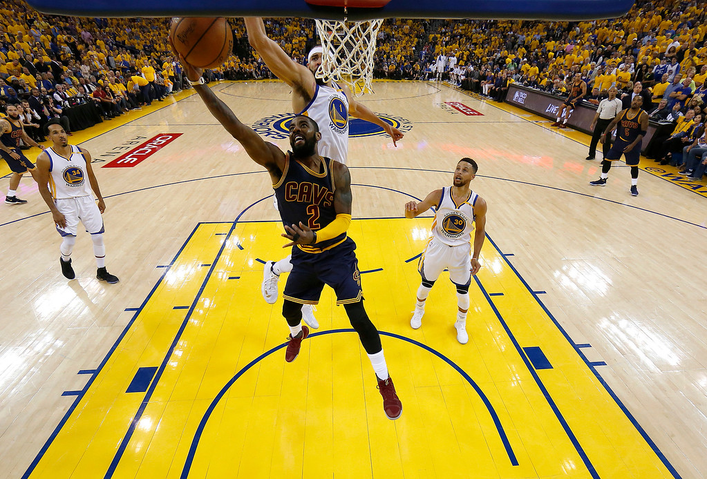 . Cleveland Cavaliers guard Kyrie Irving (2) shoots against Golden State Warriors center JaVale McGee (1) during the first half of Game 1 of basketball\'s NBA Finals in Oakland, Calif., Thursday, June 1, 2017. (AP Photo/Marcio Jose Sanchez, Pool)