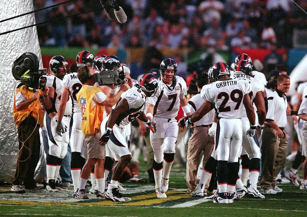 . ohn Elway takes to the field during  introductions at Pro Player Stadium Sunday prior to the start of  Super Bowl XXXIII.  (Karl Gehring/The Denver Post)