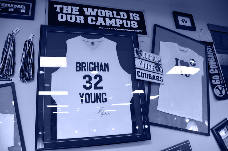 2012-5-17 ––– Lisa and I grabbed a bite to eat at a fast food place in Provo called JCW's. Inside they had this wall decorated with BYU things. It is very near the campus. The jersey with the #32 was from Jimmer, BYU's super star basketball player for the past four years. He now plays in the NBA for the Sacramento Kings.