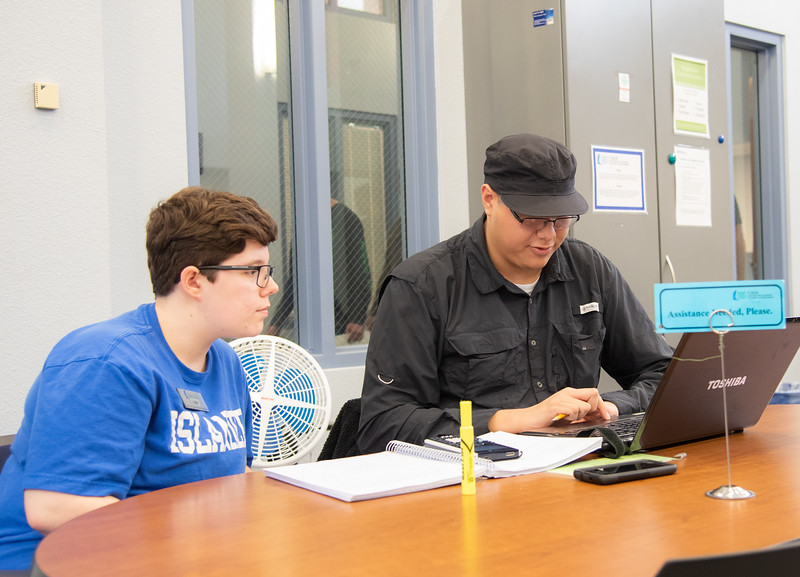 Heidi Martell(left) is helping Joe Cruz on his work at CASA.