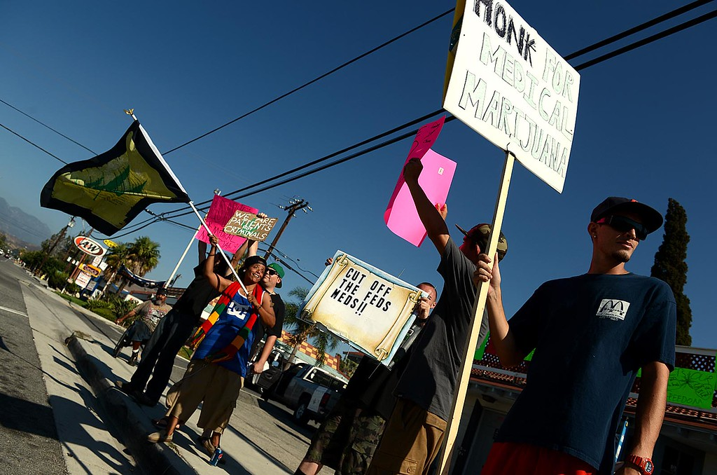 . Supporters of Doc Holliday\'s Collective, in Mentone, protest the closure of the medical marijuana dispensary Monday August 12, 2013.  (Photo by Rick Sforza/Redlands Daily Facts)