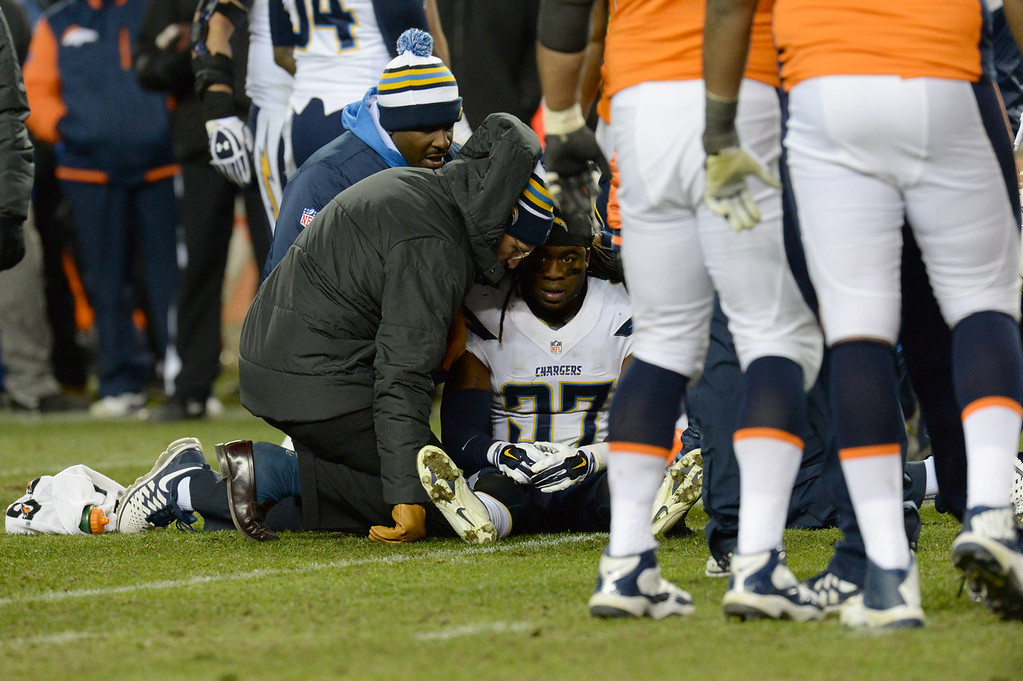 . San Diego Chargers defensive back Jahleel Addae (37) is slow to get up in the fourth quarter. The Denver Broncos take on the San Diego Chargers at Sports Authority Field at Mile High in Denver on January 12, 2014. (Photo by Hyoung Chang/The Denver Post)
