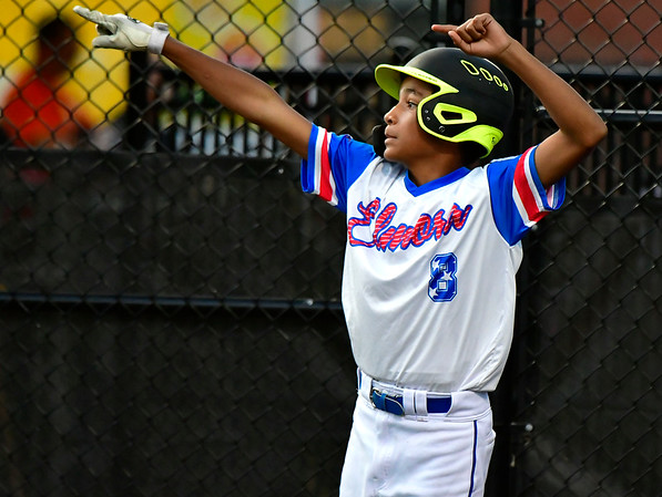 8/10/2019 Mike Orazzi | Staff New Jersey Elmora Youth Little League's Jayden Capindica (8) after scoring during Saturday's Mid Atlantic Final baseball game with New York at Breen Field in Bristol, Conn.