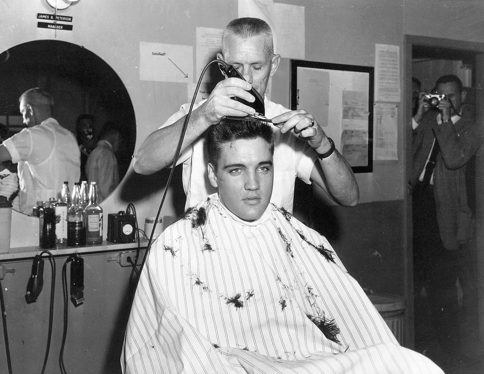 . ** FILE ** In this March 1958 file photo, singer Elvis Presley gets his hair cut before entering the Army at Fort Chaffee in Barling, Ark. According the the U.S. Army, Presley entered the service March 24, 1958, at Fort Chaffee Reception Station. (AP Photo/File)