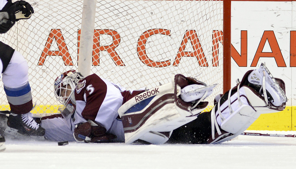 . Goalie Jean-Sebastien Giguere #35 of the Colorado Avalanche dives back into the net to make a save against the Colorado Avalanche during the first period in NHL action on December 08, 2012 at Rogers Arena in Vancouver, British Columbia, Canada.  (Photo by Rich Lam/Getty Images)