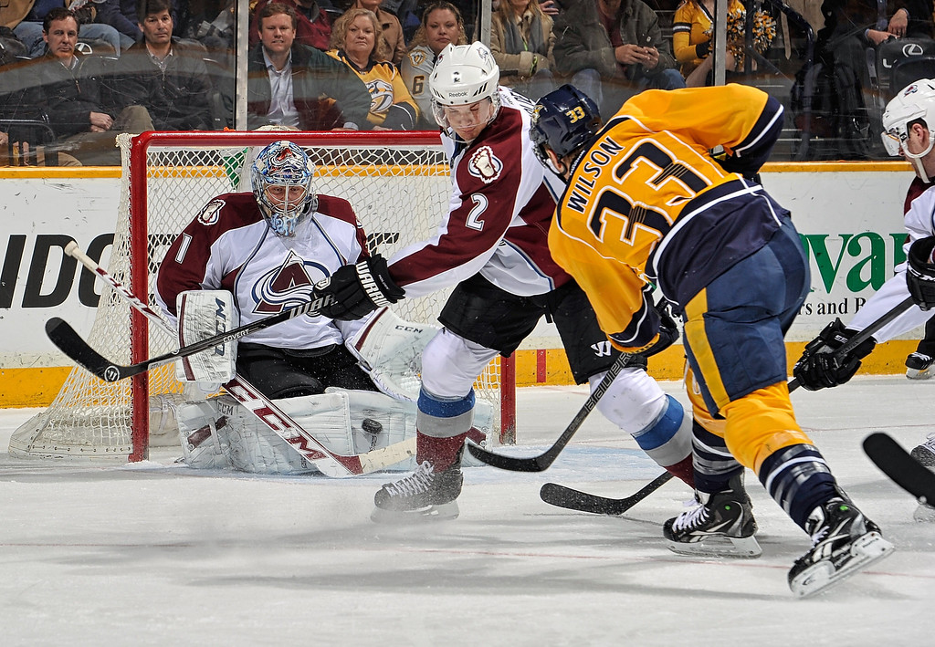 . Goalie Semyon Varlamov #1 of the Colorado Avalanche makes a save on a shot by Colin Wilson #33 of the Nashville Predators at Bridgestone Arena on March 25, 2014 in Nashville, Tennessee.  (Photo by Frederick Breedon/Getty Images)