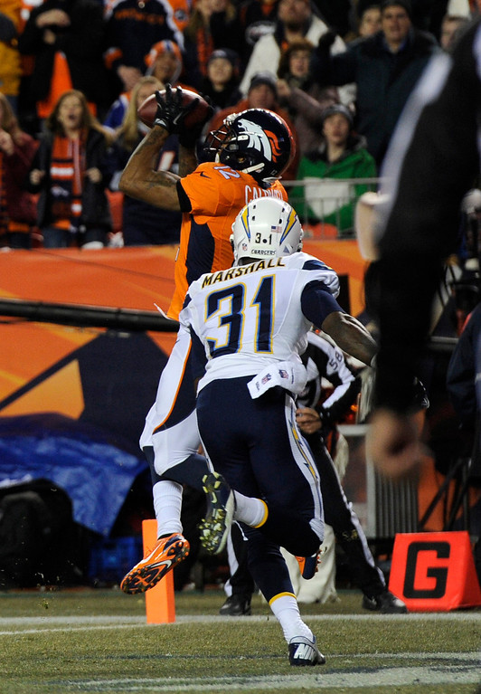 . Denver Broncos wide receiver Andre Caldwell (12) makes a catch in the end zone for a first quarter touchdown. The Denver Broncos vs. the San Diego Chargers at Sports Authority Field at Mile High in Denver on December 12, 2013. (Photo by Joe Amon/The Denver Post)