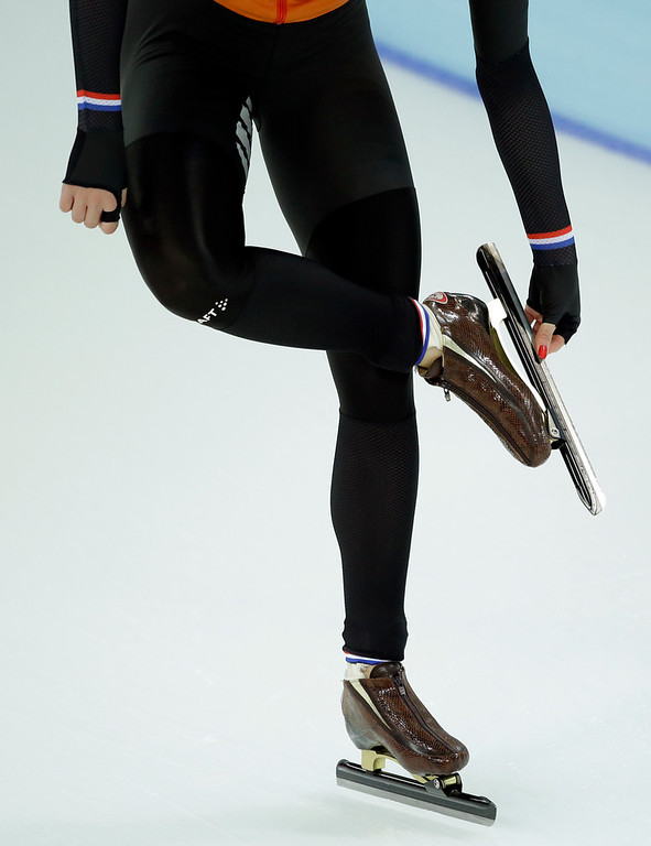 . Margot Boer of the Netherlands cleans her skate prior to the start of the second heat in the women\'s 500-meter speed skating race at the Adler Arena Skating Center during the 2014 Winter Olympics, Tuesday, Feb. 11, 2014, in Sochi, Russia. (AP Photo/Patrick Semansky)