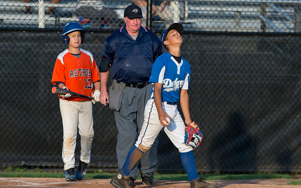 08/26/19 Wesley Bunnell | Staff The McCabe-Waters Astros defeated the Forrestville Dodgers 3-0 at Breen Field on Monday night in the city series to force a winner takes all on Wednesday. Aiden Lopez (21) reacts after the runner was ruled safe on a close play at home.