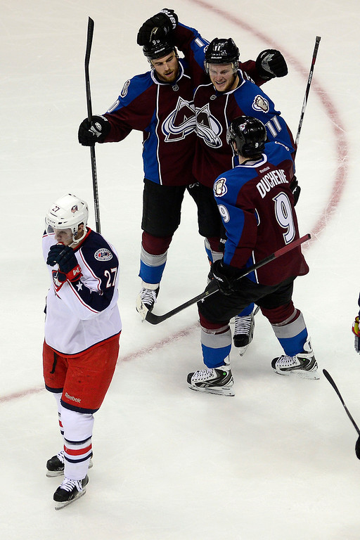 . Ryan O\'Reilly (90) of the Colorado Avalanche celebrates his go-ahead 3-2 goal with teammates Matt Duchene (9) and Jamie McGinn (11) as Ryan Murray (27) of the Columbus Blue Jackets reacts during the second period. The Colorado Avalanche hosted the Columbus Blue Jackets at the Pepsi Center on Tuesday, December 31, 2013. (Photo by AAron Ontiveroz/The Denver Post)