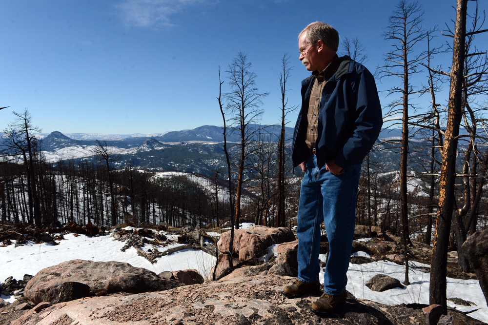 . Scott Appel tours the site of his home that was destroyed in the Lower North Fork fire last year, in Unincorporated Jefferson County, CO March 14, 2013. Appel\'s wife, Ann, is one of three people that died in the fire that destroyed 27 homes. Appel is among nearly 100 people who have made claims for damages against the state.  (Photo By Craig F. Walker/The Denver Post)