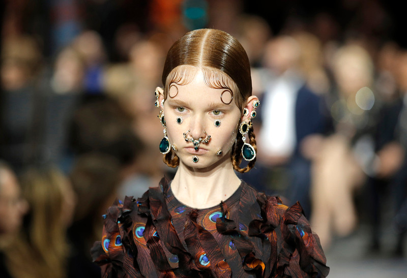 . A model wears a creation for Givenchy\'s ready to wear fall-winter 2015-2016 fashion collection during Paris fashion week, Paris, France, Sunday, March 8, 2015. (AP Photo/Francois Mori)