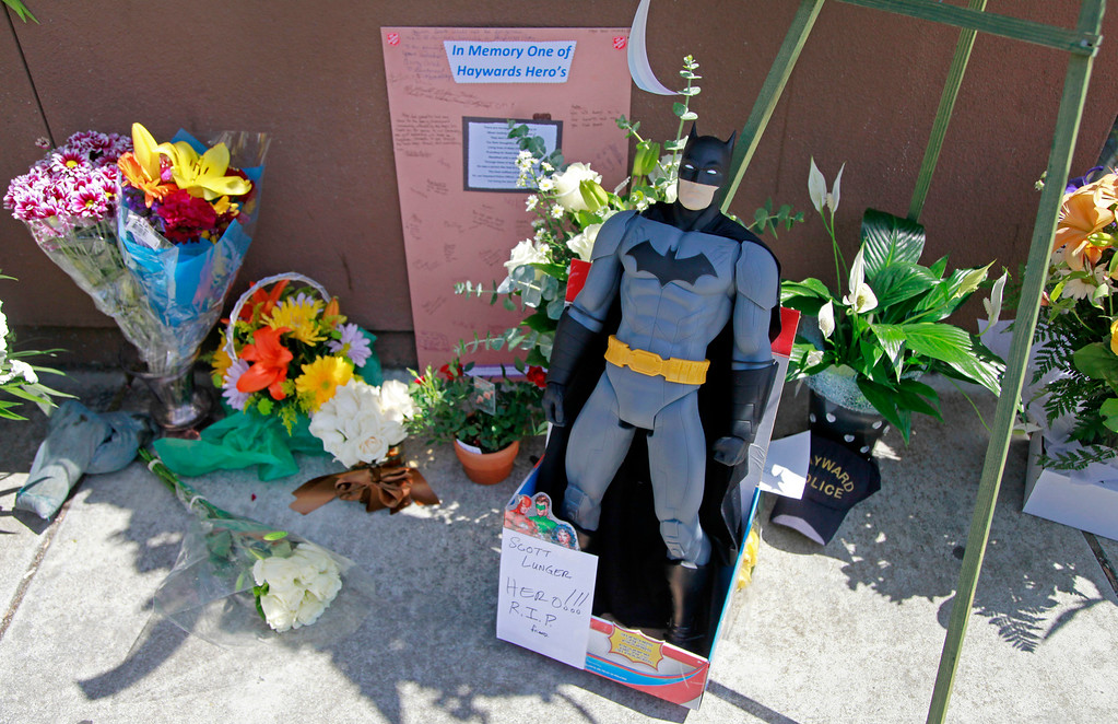 . Flowers and cards of condolences for fallen Sgt. Scott Lunger pile up outside the Hayward Police Department in Hayward, Calif., on Wednesday, July 22, 2015. Lunger was shot and killed early Wednesday morning during a routine traffic stop. (Laura A. Oda/Bay Area News Group)