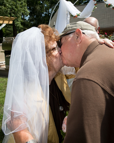 Mam and Badge Kissing at the altar 2.jpg