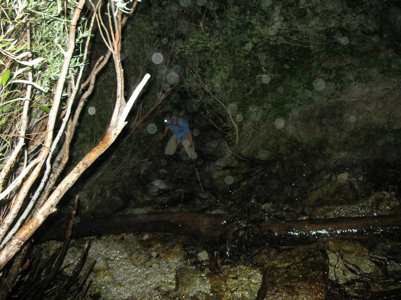 Rafael crossing creek near the waterfall