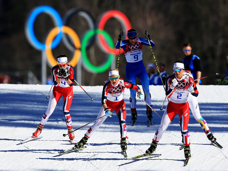 . (R-L) Marit Bjoergen, Therese Johaug and Heidi Weng of Norway compete in the Ladies\' Skiathlon 7.5 km Classic + 7.5 km Free during day one of the Sochi 2014 Winter Olympics at Laura Cross-country Ski & Biathlon Center on February 8, 2014 in Sochi, Russia.  (Photo by Richard Heathcote/Getty Images)