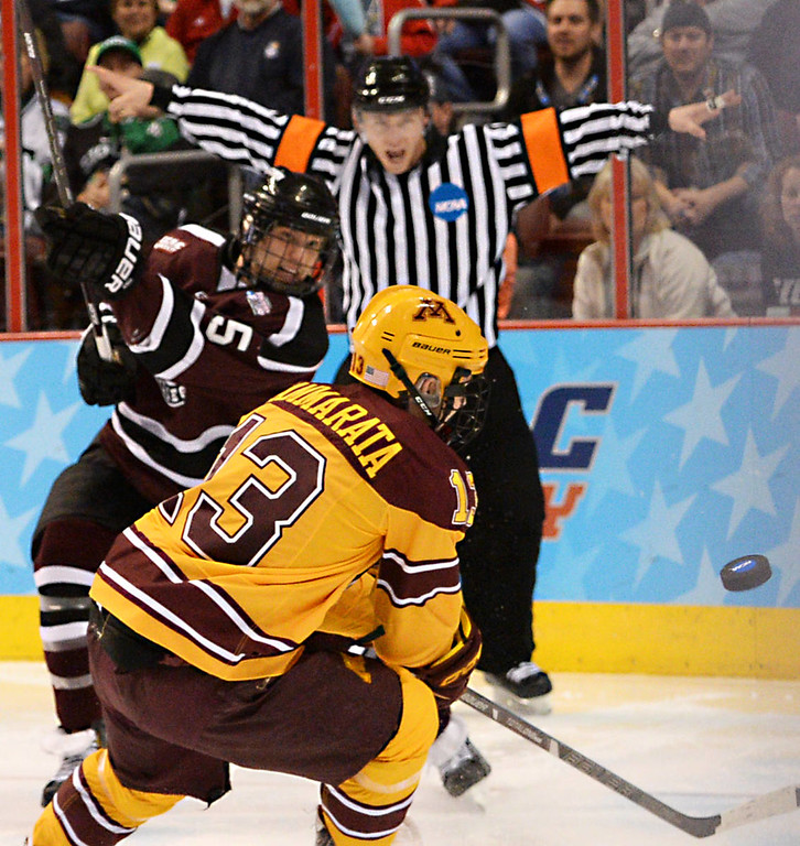 . Union College freshman defenseman Matt Krug clears the puck past Minnesota freshman forward Taylor Cammarata in the second period of the NCAA Frozen Four Championship Game at the Wells Fargo Center in Philadelphia, Saturday, April 12, 2014. Union College beat the Gophers 7-4 to claim the national championship.  (Pioneer Press: John Autey)