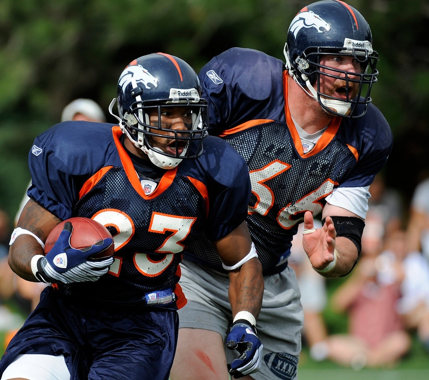 . Denver Bronco\'s running back, Andre Hall, left, scrambles while Center, Tom Nalen looks to block somebody, during training camp in 2008. THE DENVER POST/ ANDY CROSS