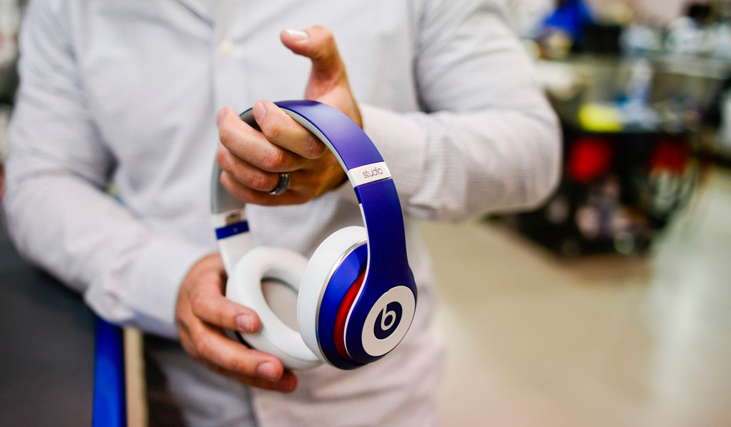 """. Jason Sobotta, ColorWare vice president of business development, holds a pair of finished Beats headphones waiting to be shipped. \""""These colors are called Midnight Diamond and Pearl,\"""" Sobotta said. (Pioneer Press: Simon Guerra)"""