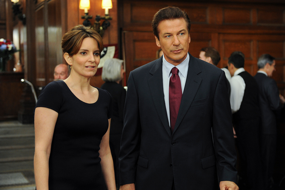 Description of . This image released by NBC shows Tina Fey, left, and Alec Baldwin in