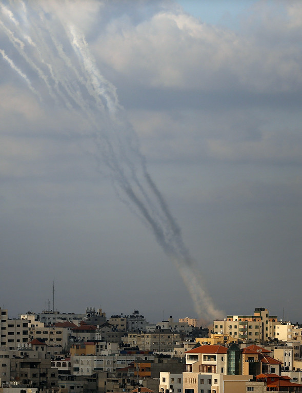 . Smoke from rockets fired from a northern neighborhood of Gaza City are seen after being launched toward Israel on July 17, 2014. Israeli air strikes in Gaza killed four children, medics said, after a humanitarian lull in a 10-day conflict that has killed 237 Palestinians. AFP PHOTO / THOMAS COEX/AFP/Getty Images