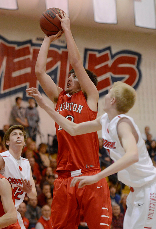 . Brighton\'s Jaren Snyder (10) goes up for a shot over Chaparral\'s Chris Moody (32) during the third quarter February 27, 2013. (Photo By John Leyba/The Denver Post)