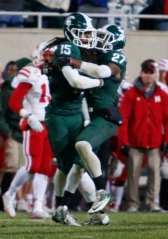 . Michigan State\'s Trae Waynes (15) celebrates his interception with Kurtis Drummond (27) with less than a minute remaining in the fourth quarter of an NCAA college football game against Nebraska, Saturday, Oct. 4, 2014, in East Lansing, Mich. Michigan State won 27-22. (AP Photo/Al Goldis)