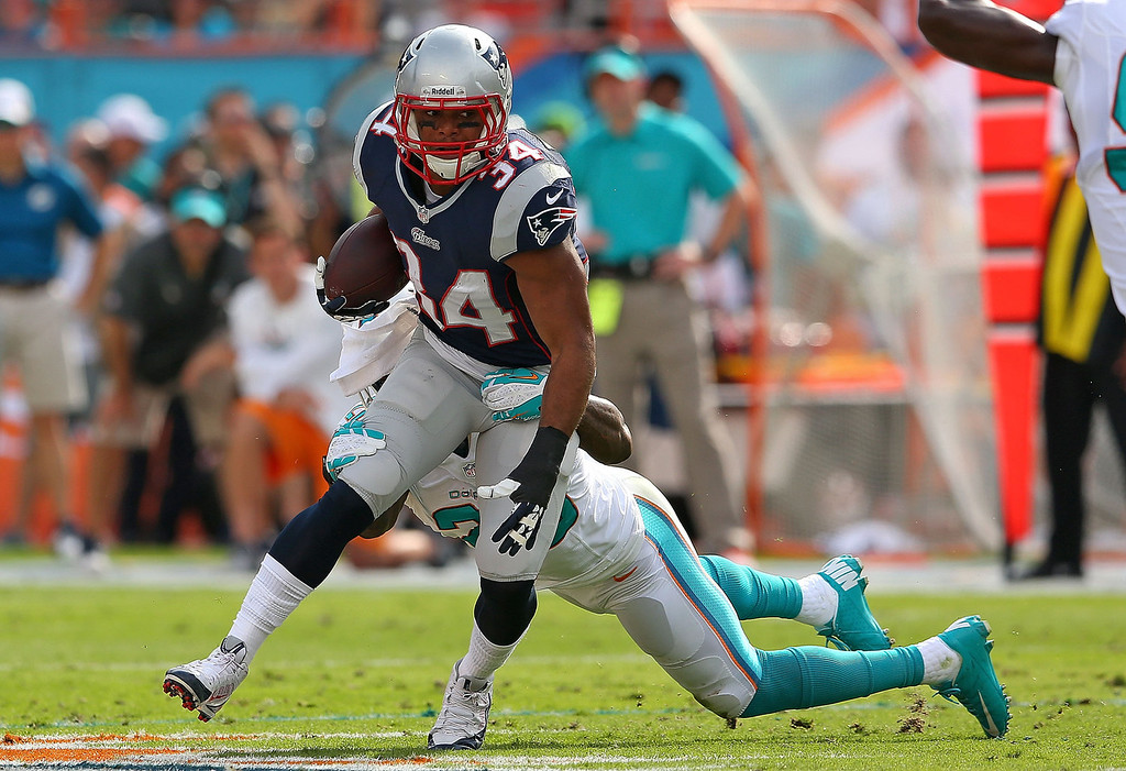 . Shane Vereen #34 of the New England Patriots rushes during a game against the Miami Dolphins at Sun Life Stadium on December 15, 2013 in Miami Gardens, Florida.  (Photo by Mike Ehrmann/Getty Images)