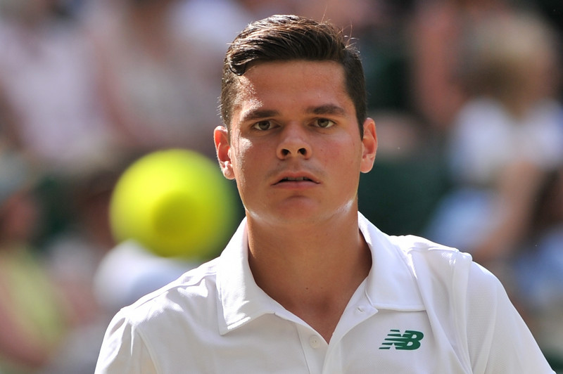 . Canada\'s Milos Raonic eyes the ball during his men\'s singles semi-final match against Switzerland\'s Roger Federer on day 11 of  the 2014 Wimbledon Championships at The All England Tennis Club in Wimbledon, southwest London, on July 4, 2014. (GLYN KIRK/AFP/Getty Images)