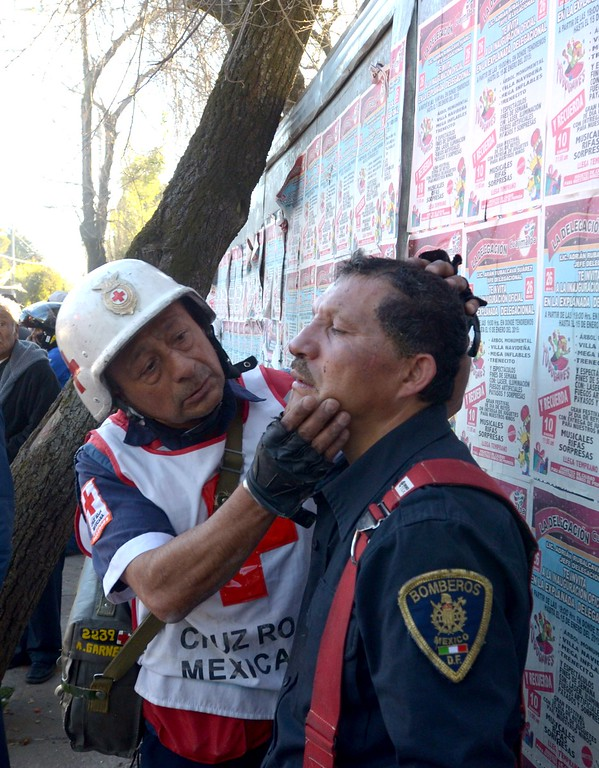 . A firefighter who had been working on the wreckage caused by an explosion in a hospital in Cuajimalpa, Mexico City, is examined by a Red Cross paramedic on January 29, 2015. A gas explosion ripped through a children\'s hospital in Mexico City on Thursday, killing at least two people and injuring dozens, including 22 children, officials said.   AFP PHOTO/DAVID  DEOLARTE/AFP/Getty Images