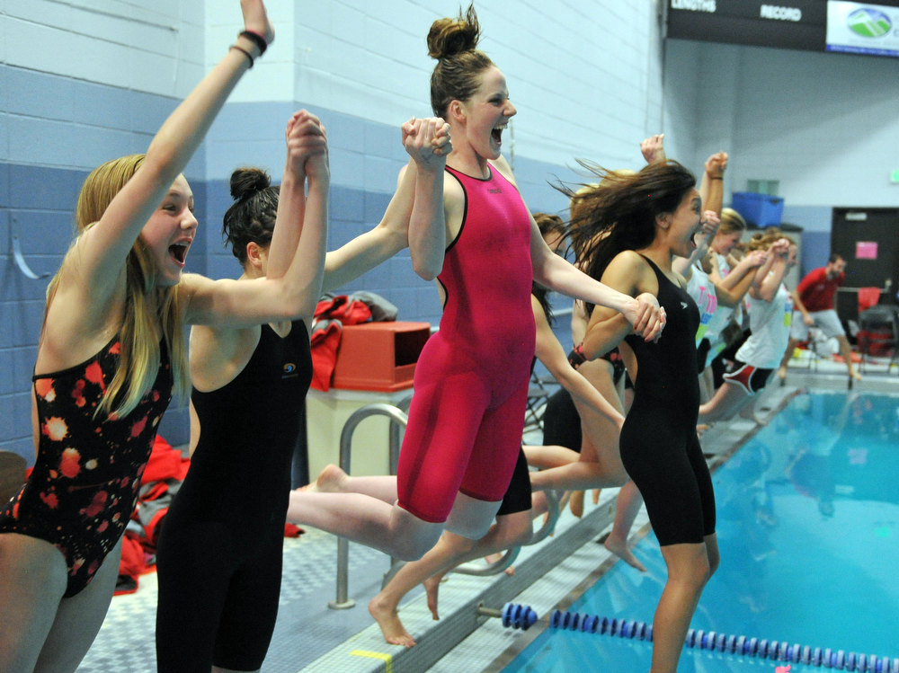 . FORT COLLINS, CO. - FEBRUARY 09: Missy Franklin, third from left, and Regis Jesuit High School swimmers jumps into the pool after winning the 5A state Championship on February 9, 2013 at Edora Pool Ice Center in Fort Collins, Colorado. (Photo By Hyoung Chang/The Denver Post)