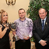 Silverbridge Harps GAC annual presentation evening in the Carrickdale Hotel. Rosie Burns PRO presenting the Mick Bailie Cup to Brendan Cumiskey B Player of the year also in picture Liam O' Neill President GAA.RS1406709